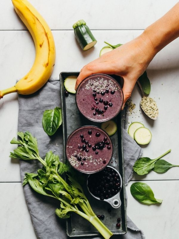 creamy zucchini blueberry smoothie in a small glass