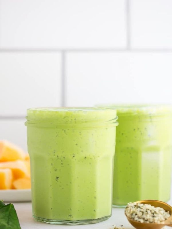 two vegan green smoothies in short glasses